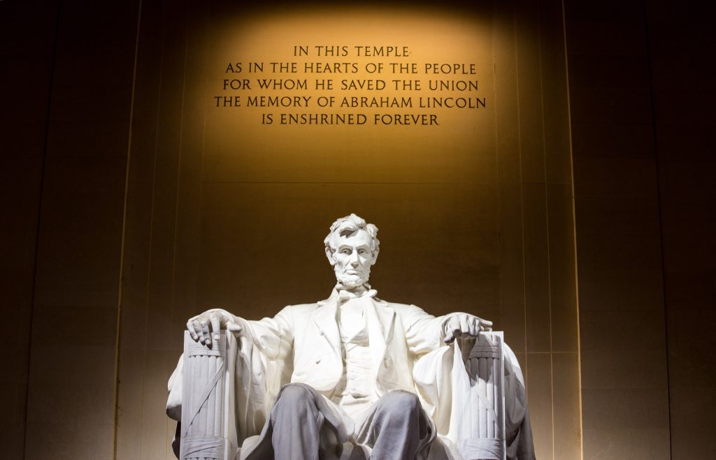 Abraham Lincoln looks down from the Lincoln Memorial.