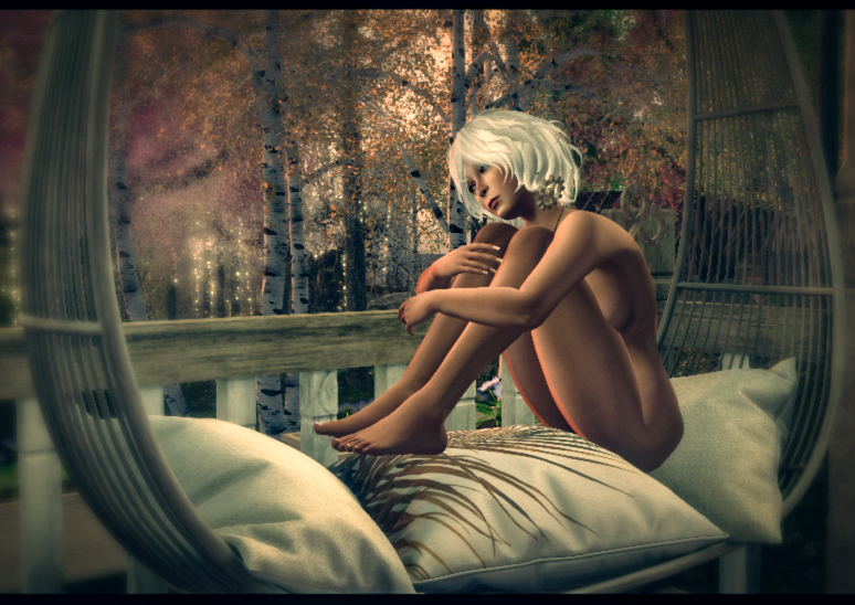 Platinum blonde lady, demurely unclad, snuggled up on pillows against a woodland backdrop
